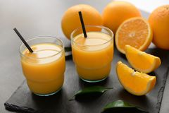 Vidros do suco de laranja fresco Foto de Stock Royalty Free