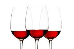 Vidros do vinho tinto isolados no branco Fotografia de Stock Royalty Free
