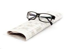 Vidros e jornal Fotografia de Stock
