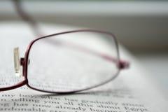 Vidros em um livro Imagem de Stock