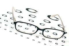 Vidros em uma carta de teste da vista do olho Foto de Stock Royalty Free