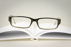 Vidros no livro branco Imagem de Stock Royalty Free