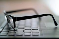 Vidros no teclado de computador Imagem de Stock