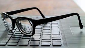 Vidros no teclado de computador Imagem de Stock Royalty Free