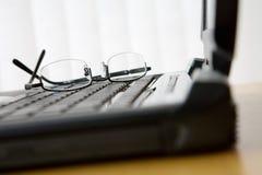 Vidros no teclado do portátil Fotos de Stock Royalty Free