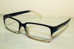 Vidros para a boa vista Melhore a visão Lente no preto imagem de stock royalty free