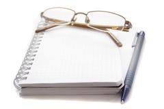 Vidros que encontram-se em um caderno Foto de Stock