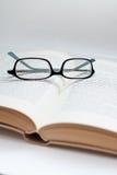 Vidros sobre um livro Foto de Stock Royalty Free
