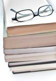 Vidros sobre um livro Imagem de Stock
