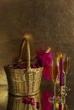 Vidros, vela e um frasco na cesta imagem de stock