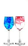 vidros vermelhos e tinta azul Fotografia de Stock