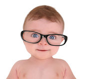 Vidros vestindo do olho do bebê pequeno no fundo branco Imagens de Stock