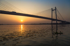 Vidyasagar bridge setu on river Hooghly at sunset. Vidyasagar bridge Setu is a cable stayed bridge on the Hooghly river in connecting the city of Kolkata with royalty free stock photography