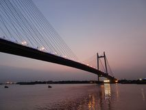 Vidyasagar Setu. The Vidyasagar Setu at evening in kolkata / Calcutta above the Ganges decorated with light taken from Princep Ghat Royalty Free Stock Images