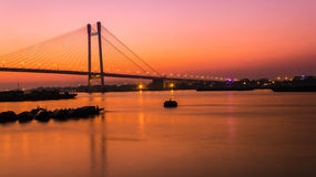 Vidyasagar Setu at Twilight. Beautiful Vidyasagar Setu at twilight 2 over river Ganges in Kolkata Stock Photography