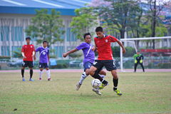 Vie for the ball from socker in thailand. Association football, more commonly known as football or soccer, is a sport played between two teams of eleven players stock photography