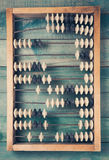 Vieil abaque de vintage sur le fond en bois Images stock