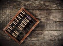 Vieil abaque sur la table en bois Images libres de droits