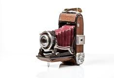 Vieil appareil-photo antique de photo d'isolement sur le blanc Photos libres de droits