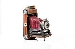 Vieil appareil-photo antique de photo d'isolement sur le blanc Photo stock