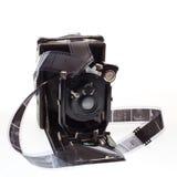 Vieil appareil-photo avec des négatifs Photo stock