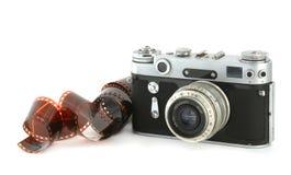 Vieil appareil-photo avec un film photographie stock libre de droits