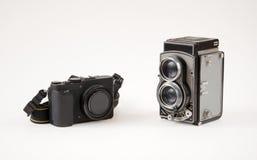 Vieil appareil-photo contre le neuf Photographie stock libre de droits