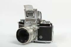 Vieil appareil-photo de photo sur le fond blanc Photo libre de droits