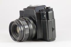 Vieil appareil-photo du film SLR sur le fond blanc Photos libres de droits