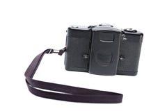 Vieil appareil-photo noir d'isolement avec la courroie image libre de droits
