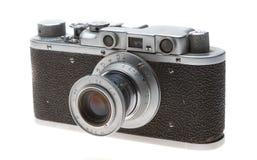 Vieil appareil-photo sur un fond blanc Images stock