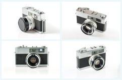 Vieil ensemble d'appareil-photo de photo d'isolement sur le fond blanc Image libre de droits