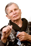 vieil essuyage d'homme de lunettes Image libre de droits