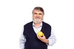 Vieil homme avec la pomme dans des mains Photographie stock libre de droits