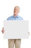 Vieil homme aîné avec le signe Photographie stock libre de droits