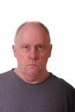 Vieil homme Balding semblant sévère photographie stock