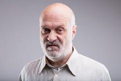 Vieil homme chauve dégoûté et déçu Image stock