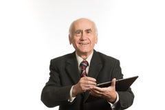 Vieil homme d'affaires avec la tablette photos stock
