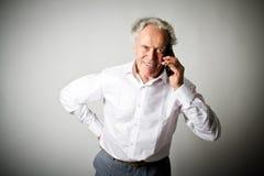 Vieil homme et téléphone intelligent Photo libre de droits