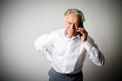 Vieil homme et téléphone intelligent Photographie stock libre de droits