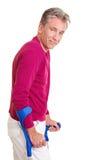 Vieil homme marchant avec des béquilles Photographie stock libre de droits