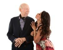 Vieil homme riche avec l'épouse d'or-bêcheur Image stock
