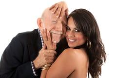 Vieil homme riche avec l'épouse d'or-bêcheur Photographie stock libre de droits