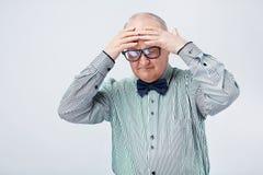 Vieil homme souffrant du mal de tête Photo libre de droits