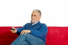 Vieil homme sur le sofa Photo libre de droits