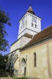 Vieille église avec la tour d'horloge, architecture de la Transylvanie Photographie stock libre de droits