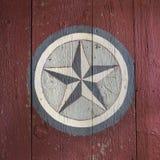 Vieille étoile peinte sur une grange Image libre de droits