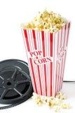 Vieille bobine de film avec le maïs éclaté Photographie stock libre de droits