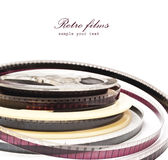 Vieille bobine de film d'isolement sur un fond blanc Photo stock