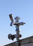 Vieille broche de l'eau sur le pilier Images stock